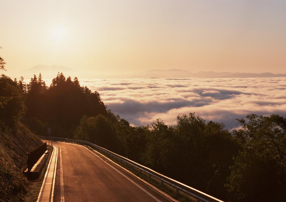 A breathtaking view of the sky at sunrise on the road