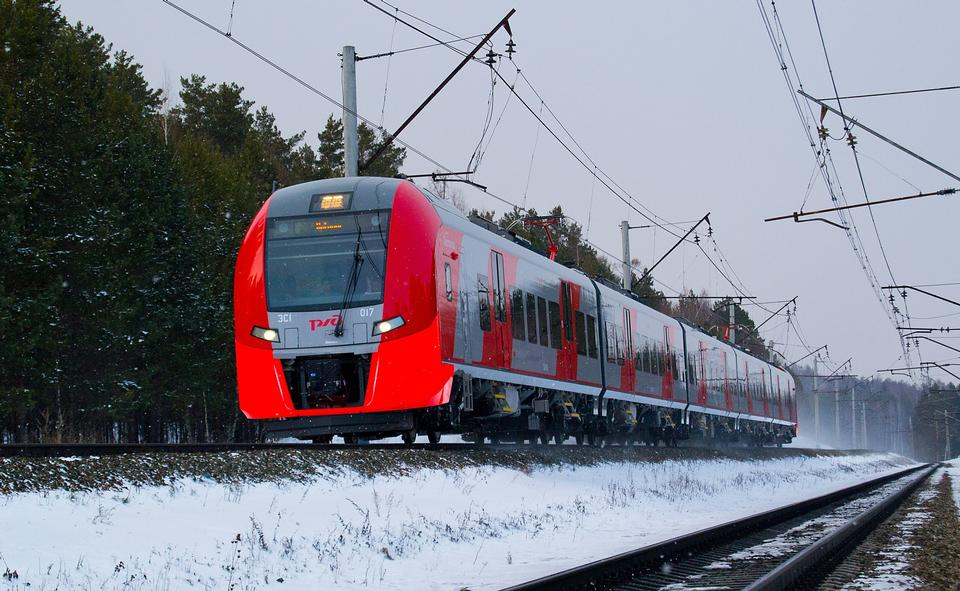 incoming suburban train in the misty winter