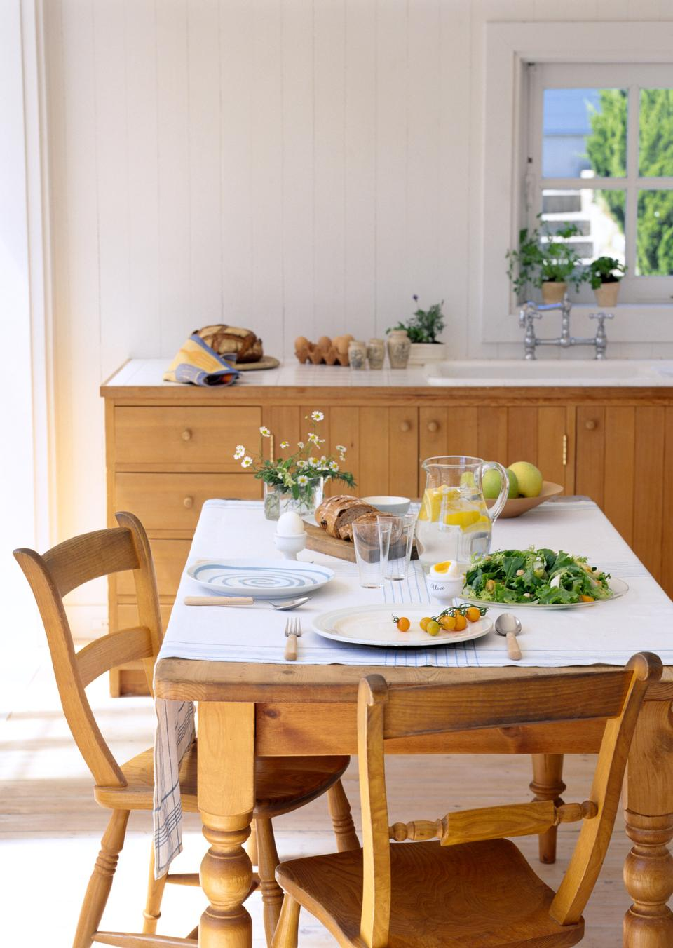 Festive well-laid table with salad and drink