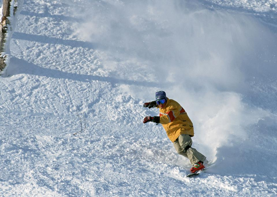 Snowboarder in action at the mountains