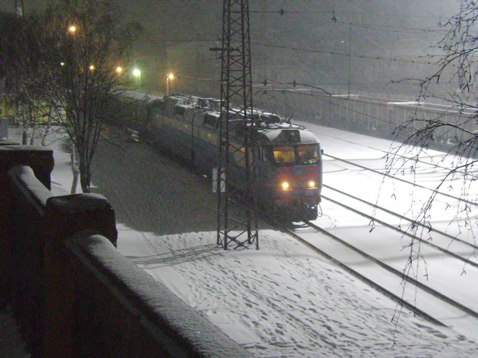 Train at railroad crossing in winter