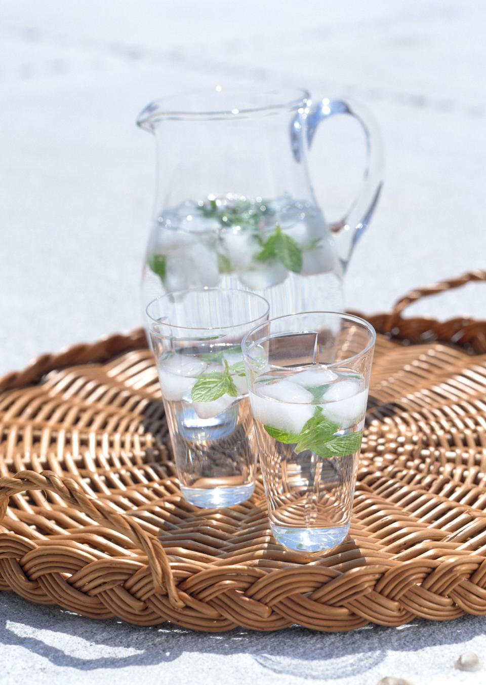 Glass of water and fresh herbs