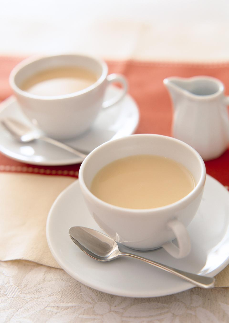 White china cup of tea with milk