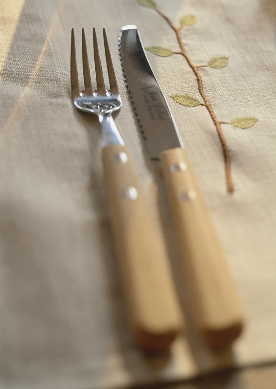 Knife and Fork on a large brown serviette