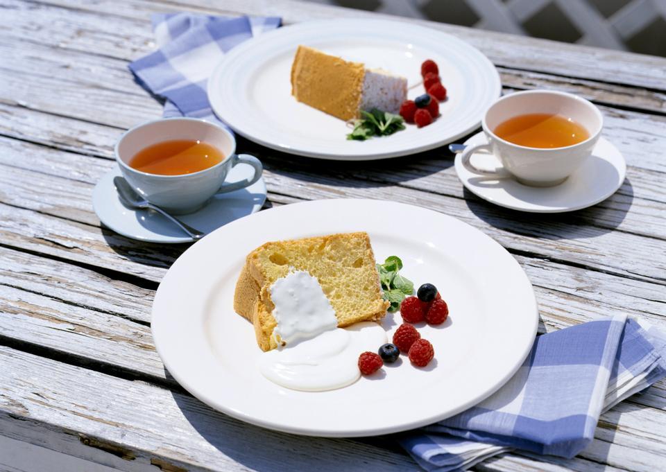 Victoria sponge cake with cream on wooden table