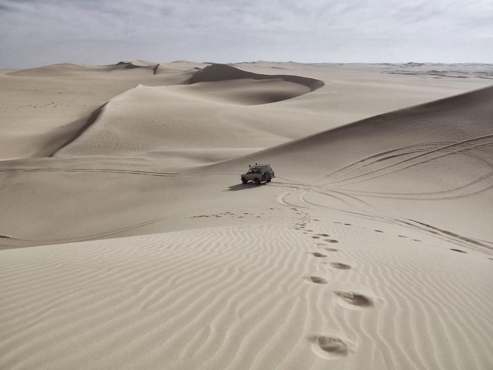 Off-road vehicle driving in the Awbari Sand Sea,