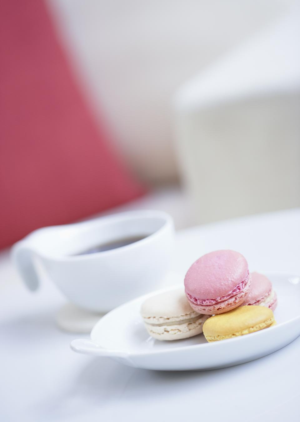 A cup of coffee and macaron