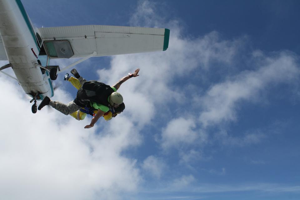 Skydiver falls through the air. Parachuting is fun