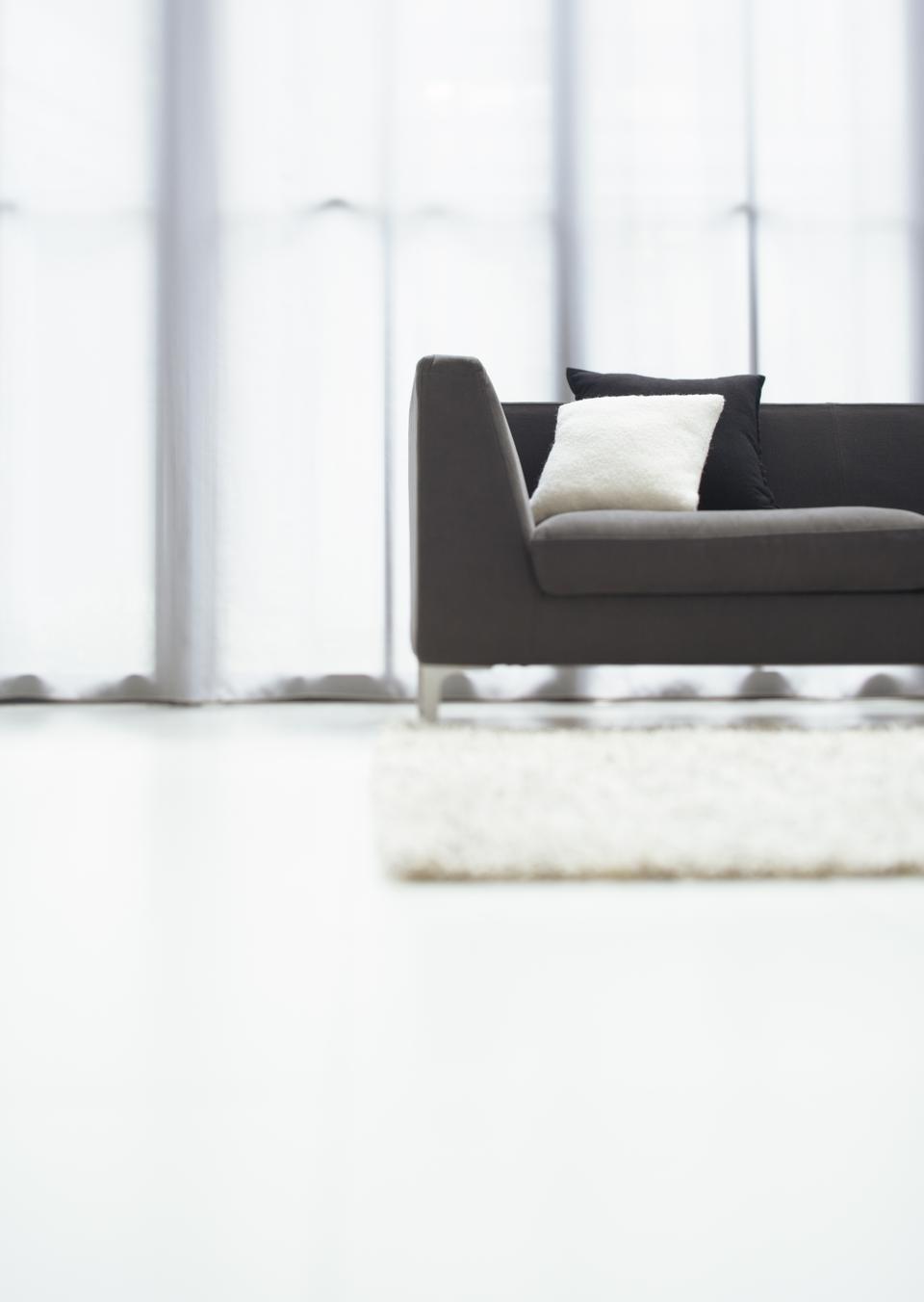 Dark sofa in room