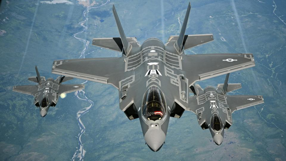 F-35A Lightning II aircraft receive fuel from a KC-10