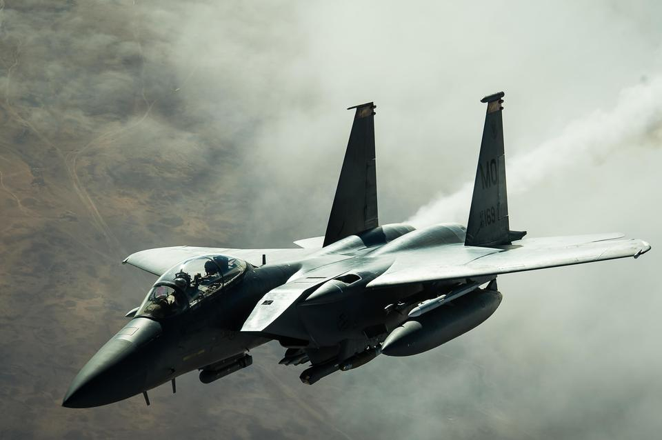 A F-15E Strike Eagle disconnects from a KC-10 Extender