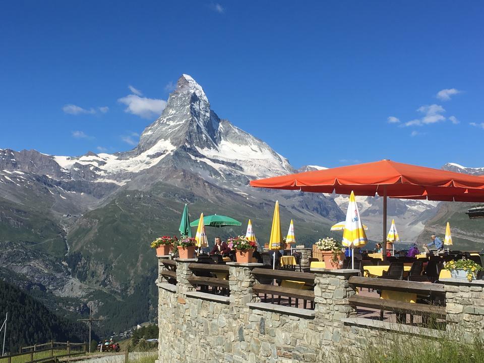 Tourist taking view of Matterhorn in autumn at outside restaurant