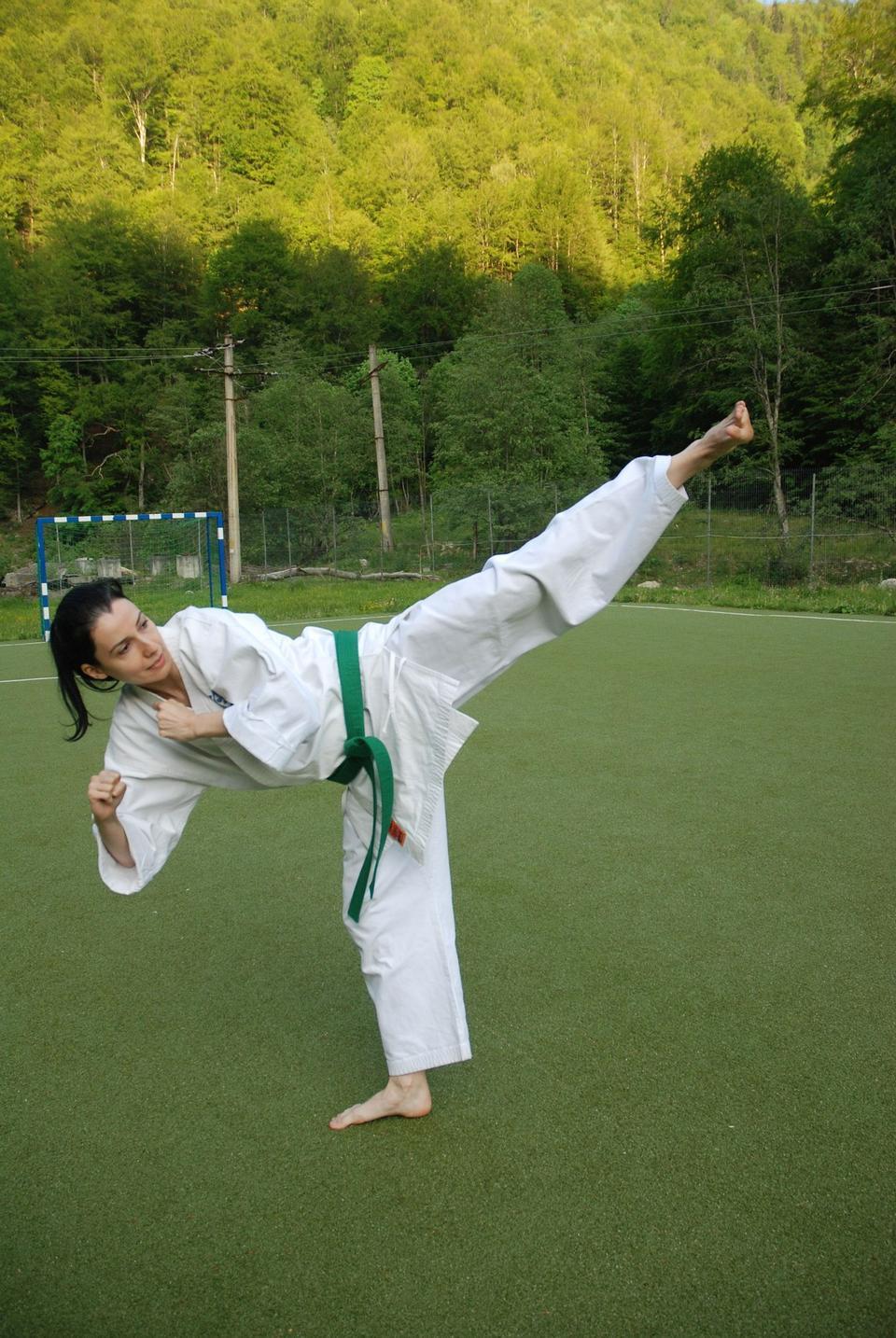 woman in kimono show marshal art foot kick