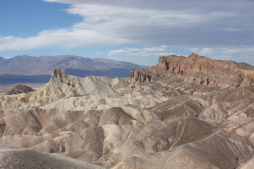 Moon Over Zabriskie Point Mudstones form Badlands Death Valley