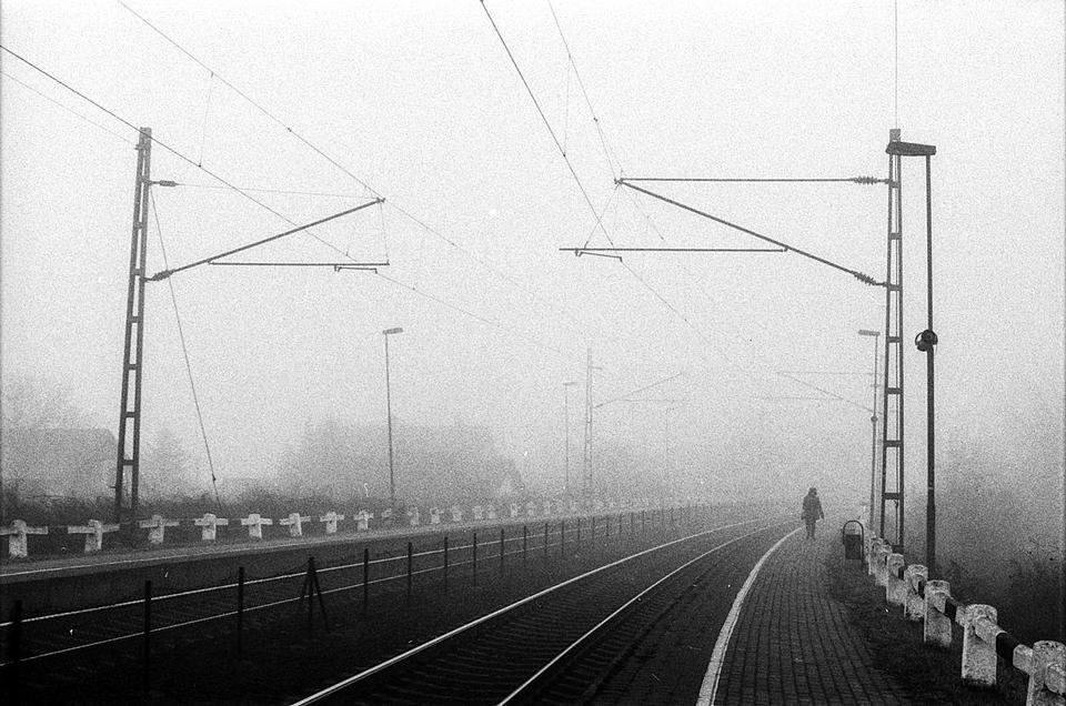 railway system with rails in dense fog