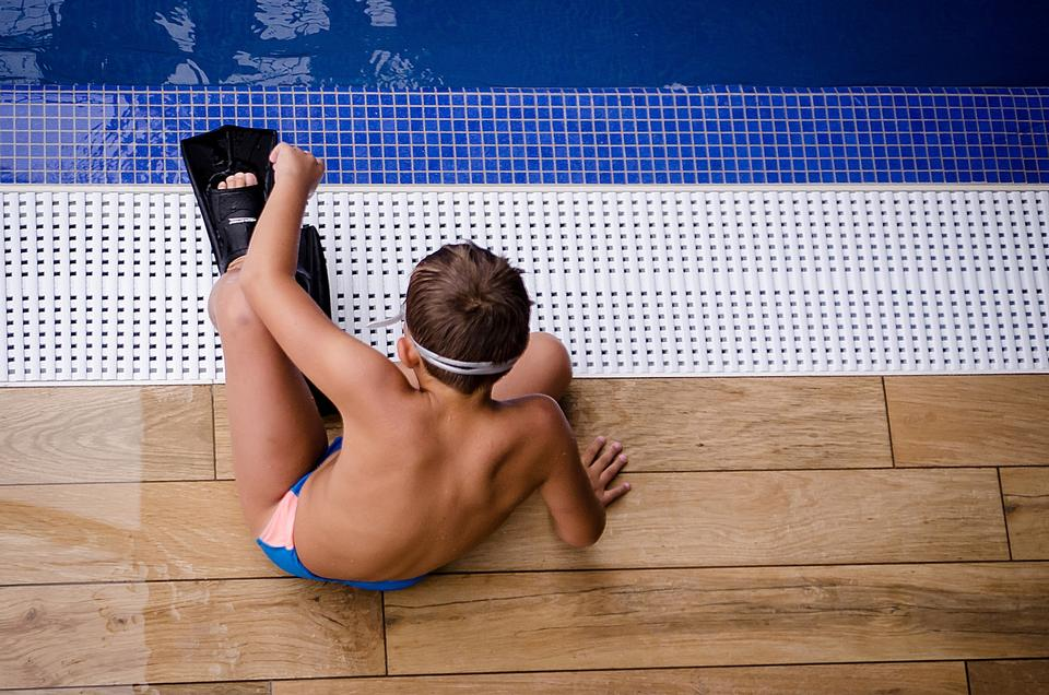 Close up of young boy swimming in pool 1.