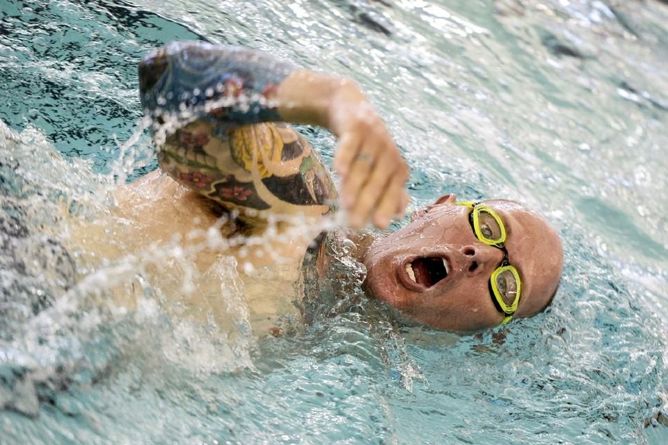 Young man swimming the front crawl