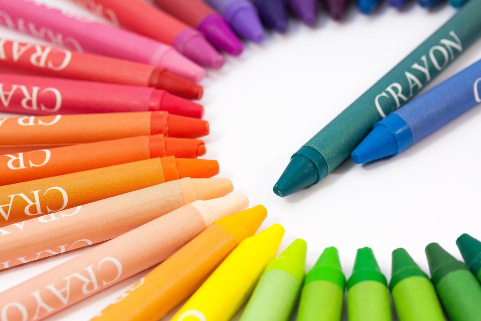 Colorful Crayons in a Slanted Row on white background