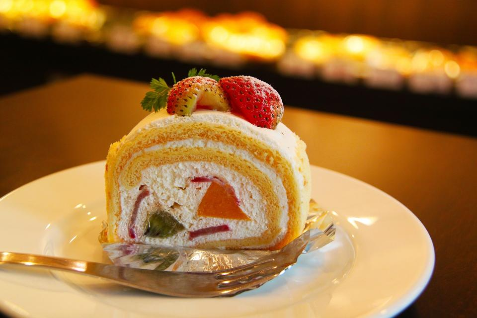 Berry roll cake on plate