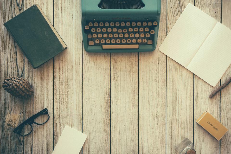 Vintage typewriter and a blank sheet of paper, retouching retro