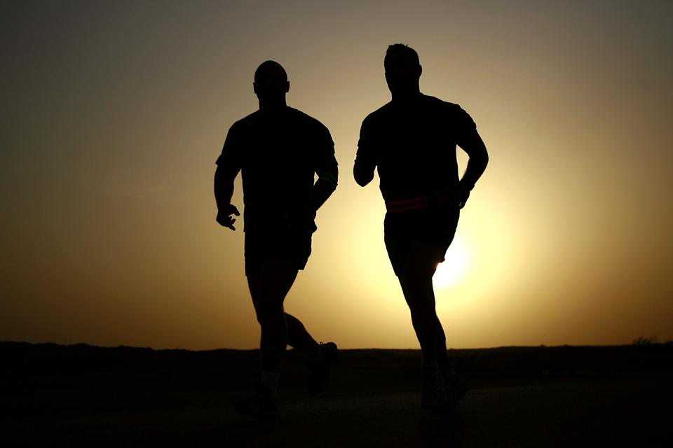 silhouettes running at sunset