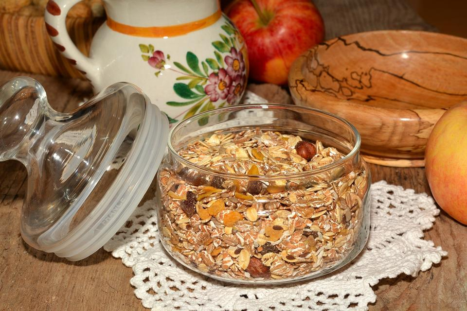 Bowl of homemade granola with various seeds and berries shot