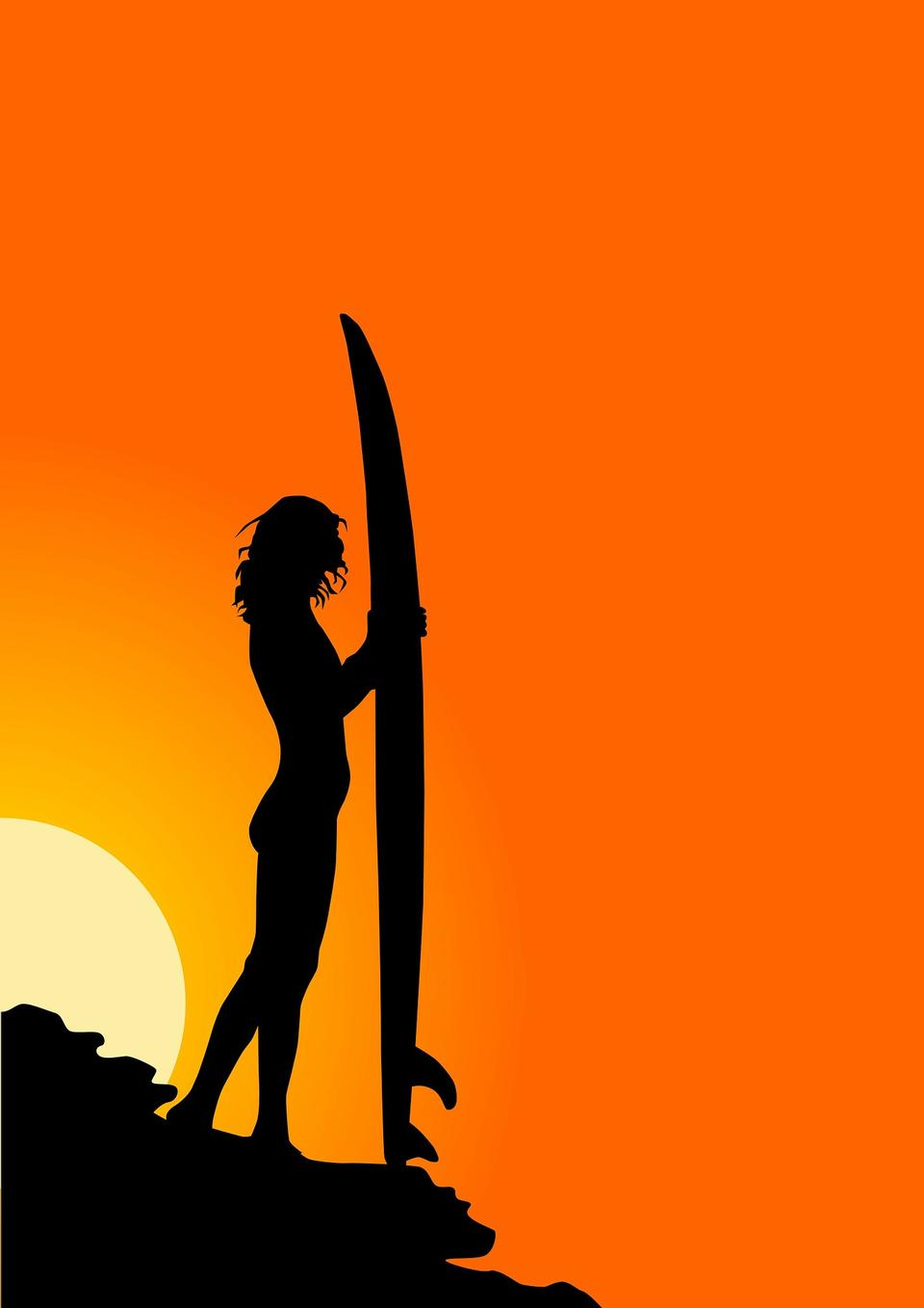 Surfer in silhouette holding long surf boards at sunset
