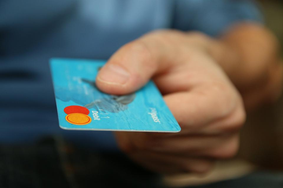 closeup of credit card holded by hand.