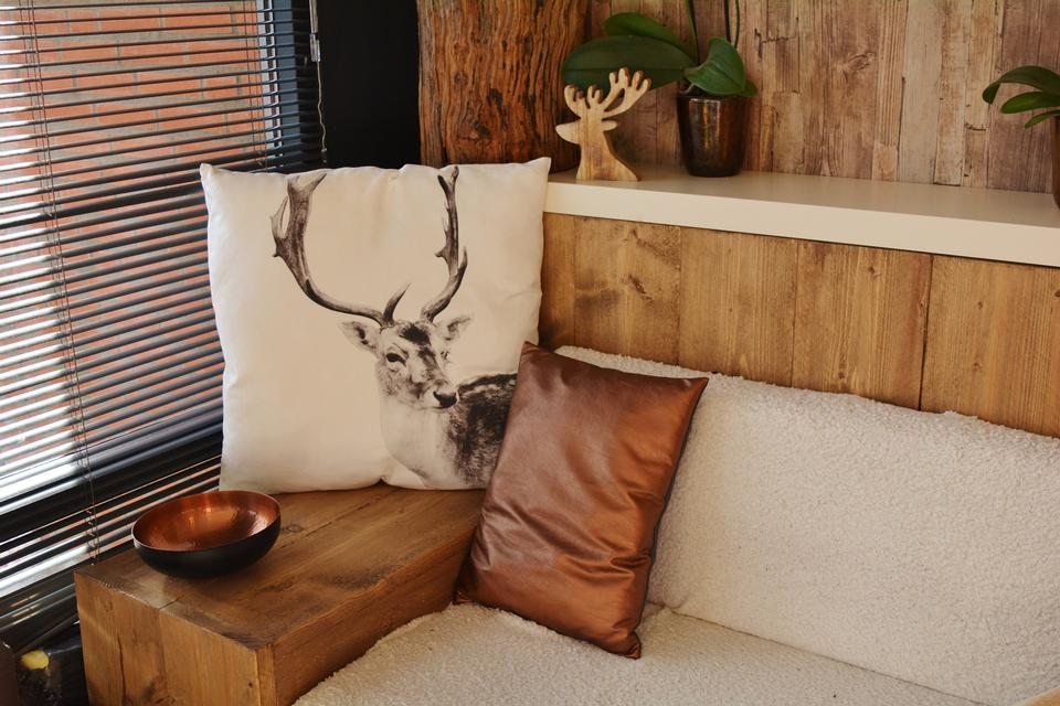 living room interior with comfortable corner couches,