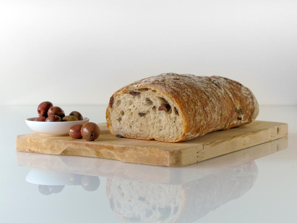 freshly baked ciabatta bread on wooden cutting board