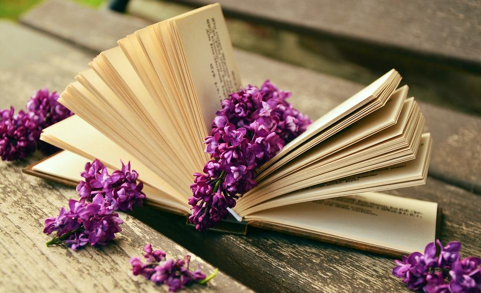 Vintage books with bouquet of flowers