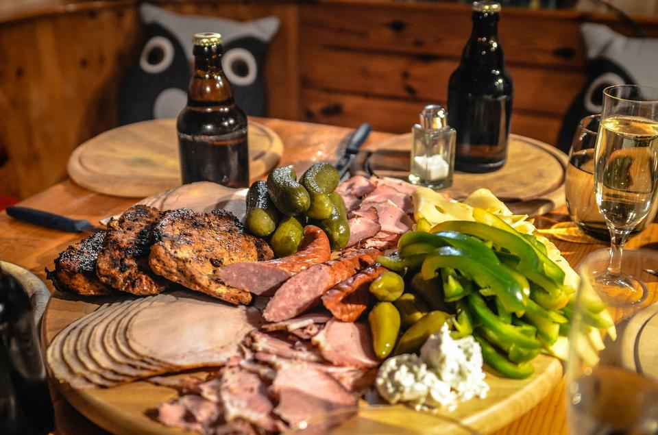 Antipasto catering platter with bacon, jerky, sausage,