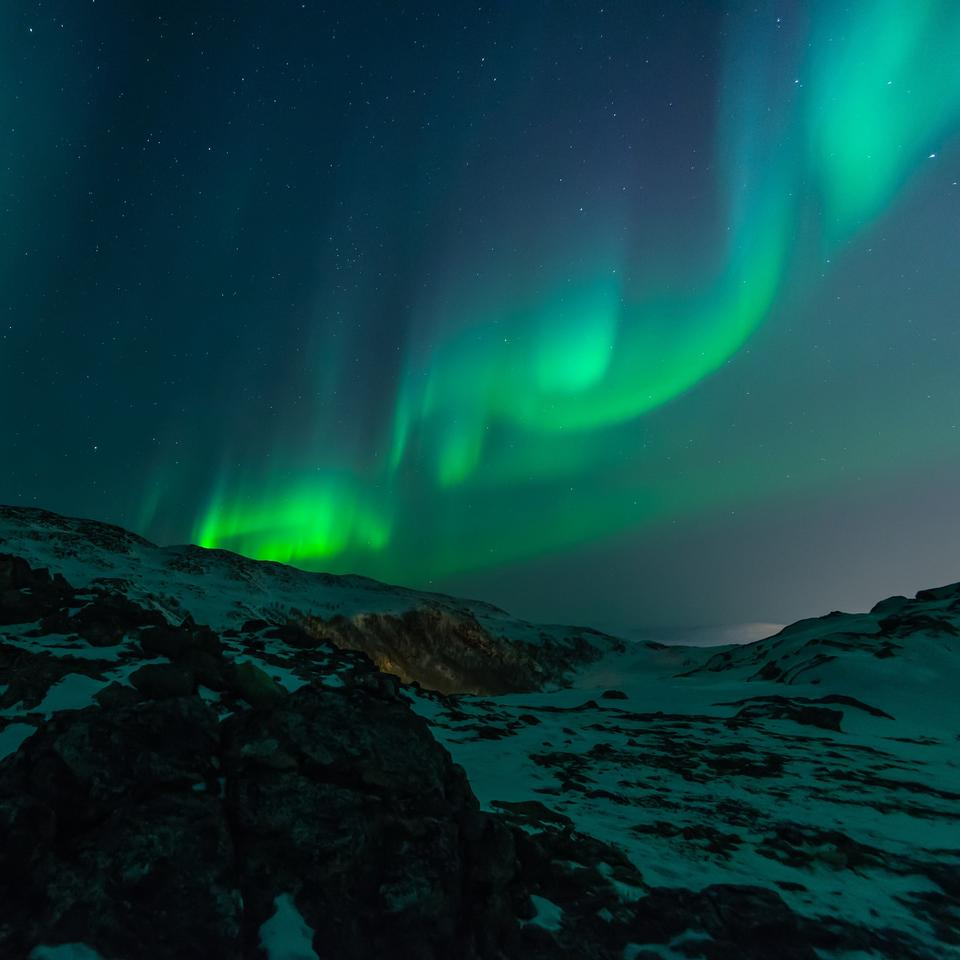 Night sky with amazing northern lights aurora borealis