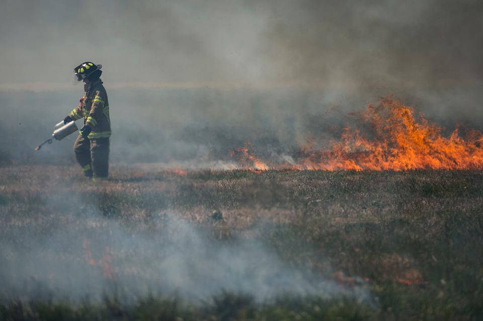 firefighters control the burn