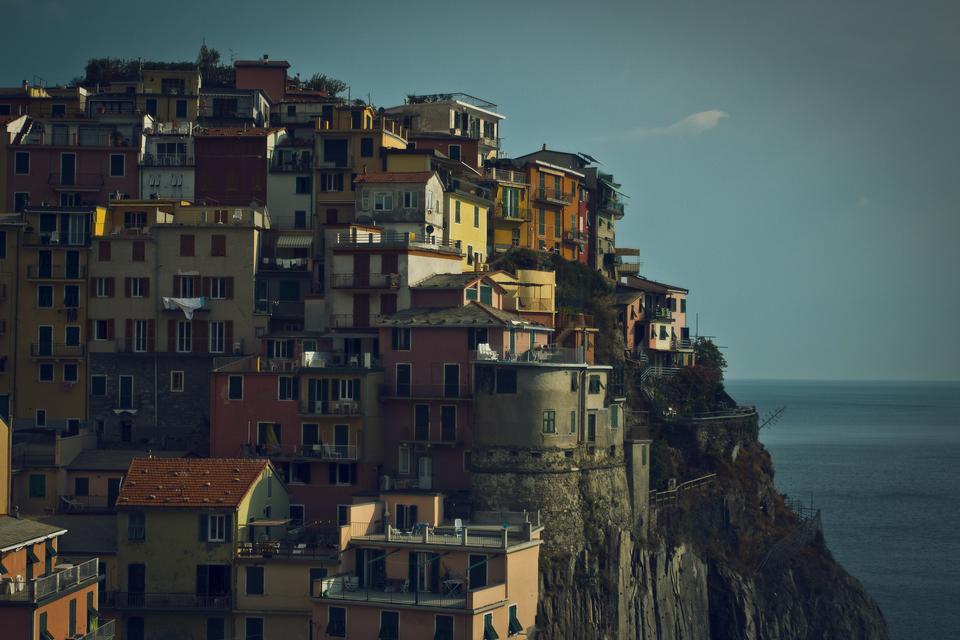 Traditional houses above the sea in Manarola, Cinque Terre, Italy