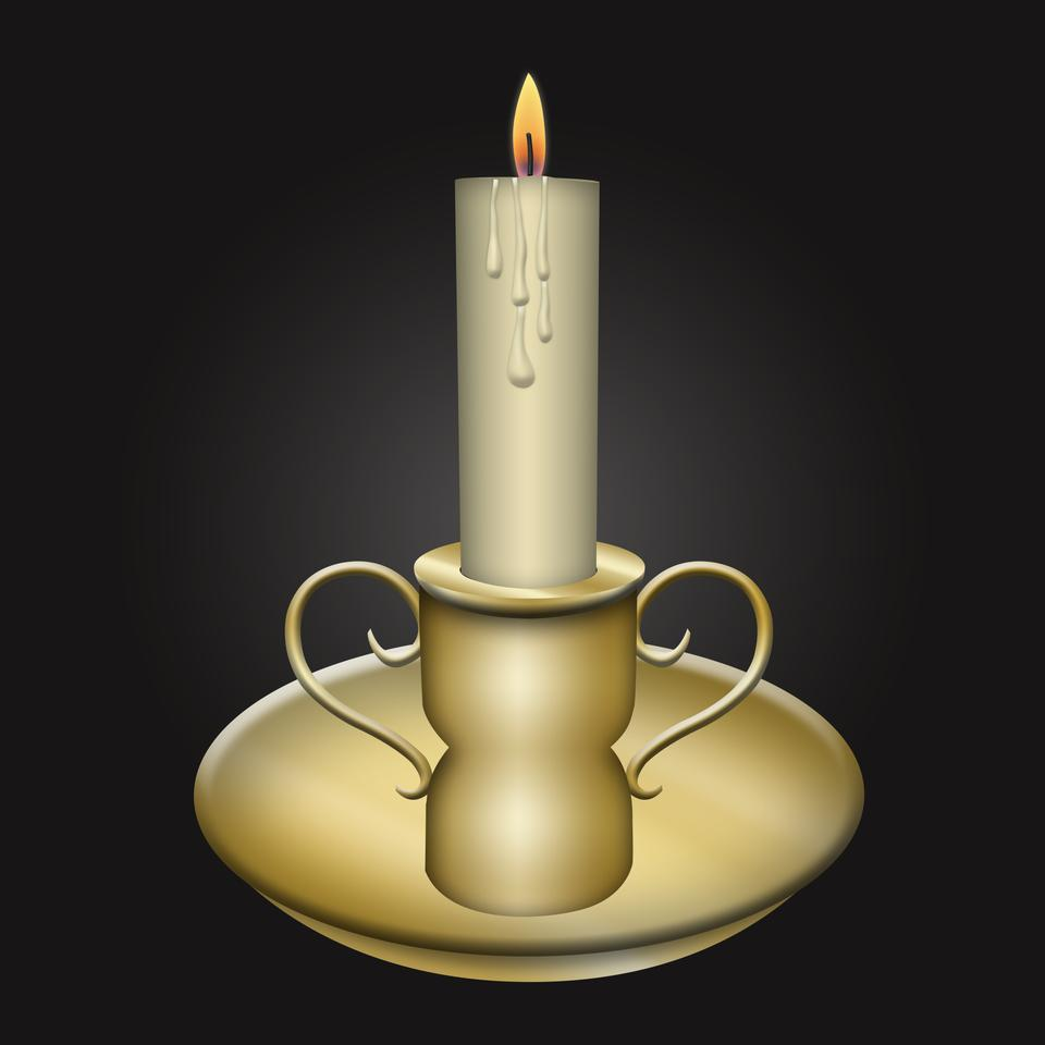 Candle on the old brass candlesticks