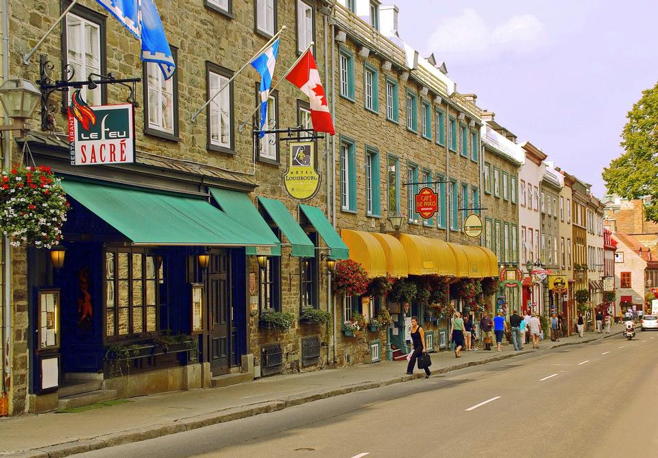 Old street with traffic in Quebec City, Canada.