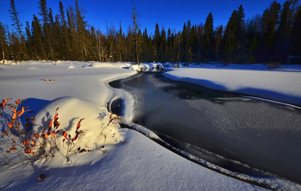 The river in the winter at sunset i