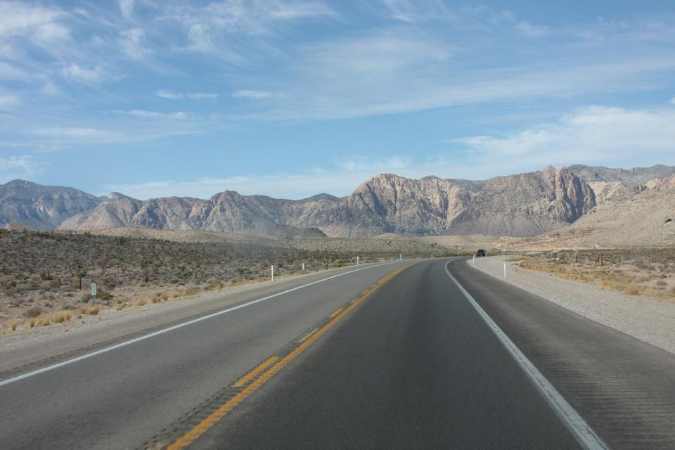 Long desert highway leading into Death Valley National Park