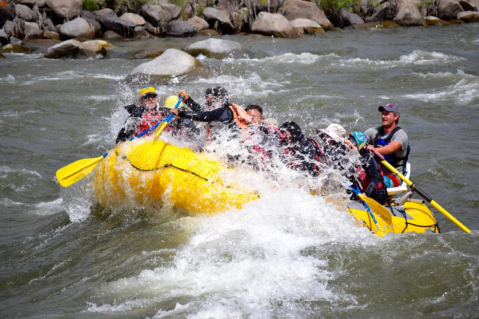 Group of happy people rafting