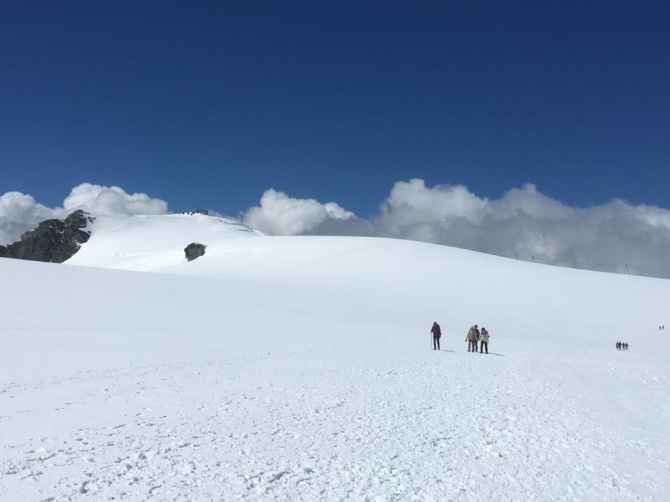 hikers team in the mountains. Matterhorn. Swiss Alps