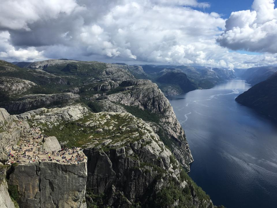 People on rocks harsh Norway, Trolltunga