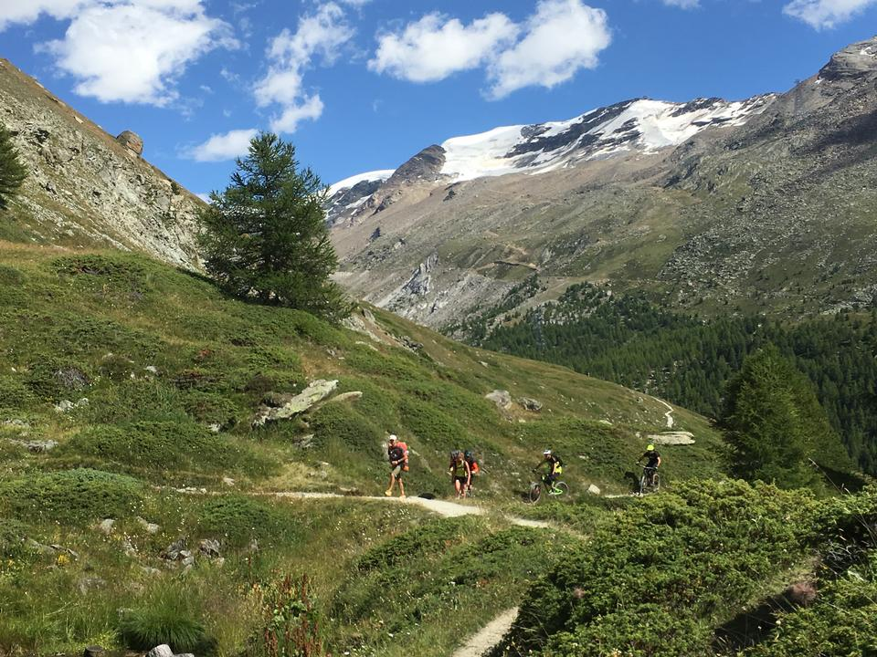 Matterhorn and cyclists enjoying the challenge on mountain trails