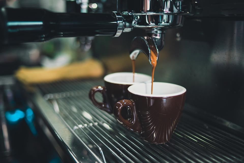 Close-up of espresso pouring from coffee machine