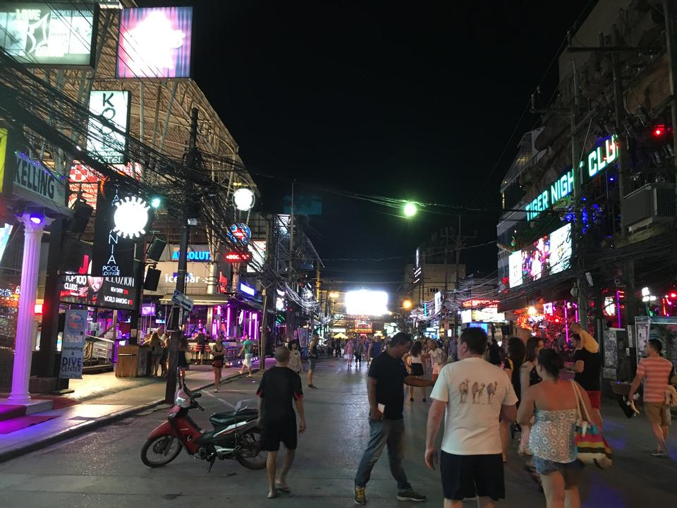 tourists are shopping at old town night market  in Phuket