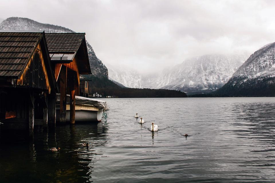 Old Wooden Boathouses in Hallstatt, Austria, on a Foggy Day
