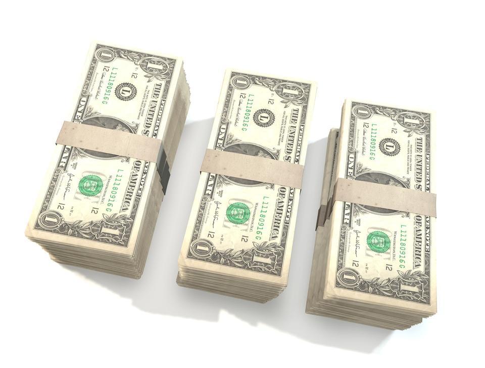 big pile of money american dollar bills on white background