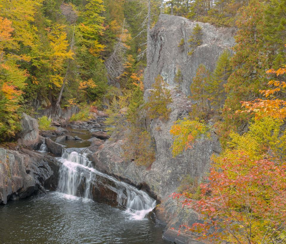 Autumn waterfalls in park with colorful foliage