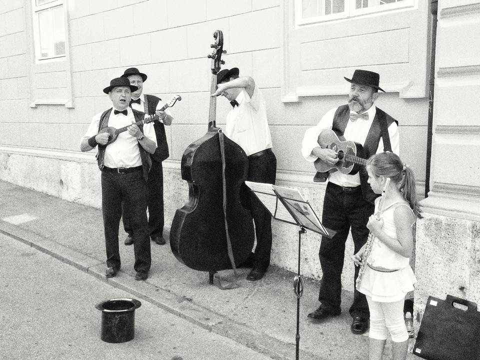 Four local musicians play on the street busking