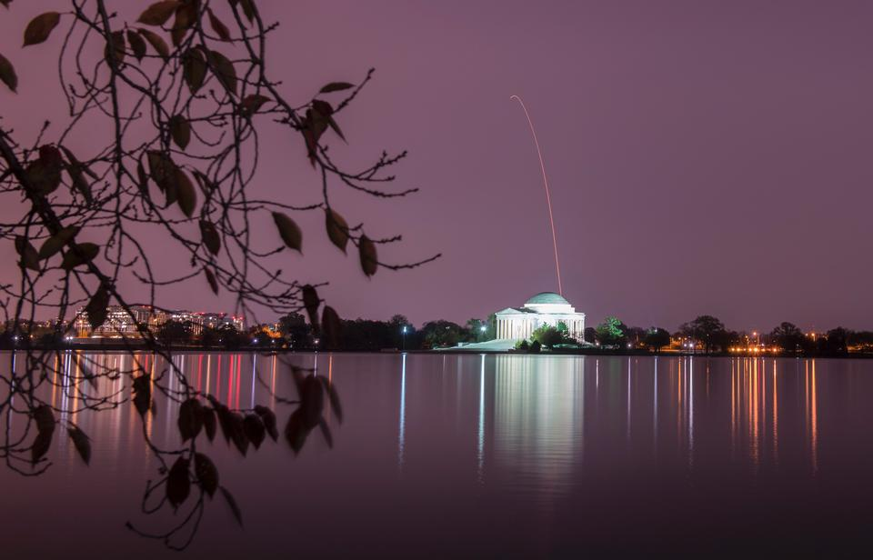 Antares rocket is seen above the Thomas Jefferson Memorial